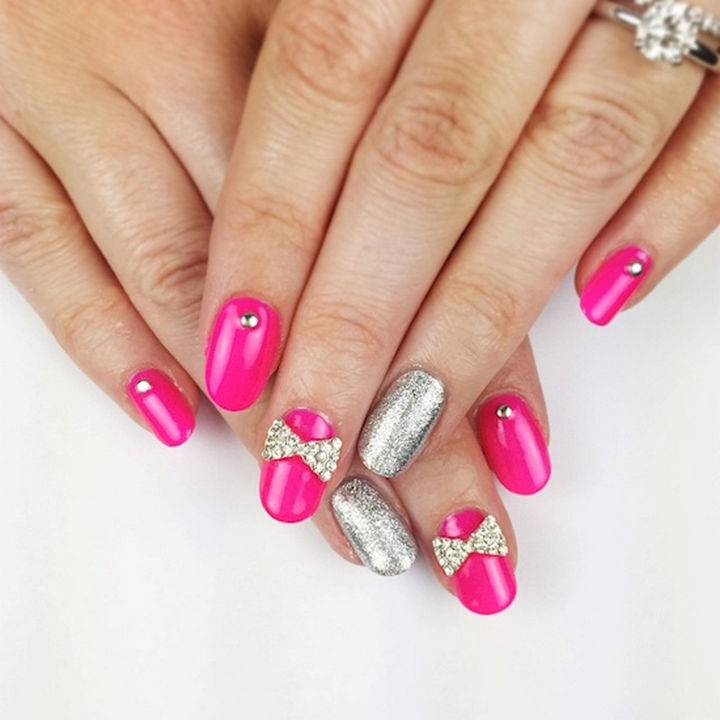 18 Perfectly Manicured Bow Nails - Beautiful pink nails with just the right amount of bling.