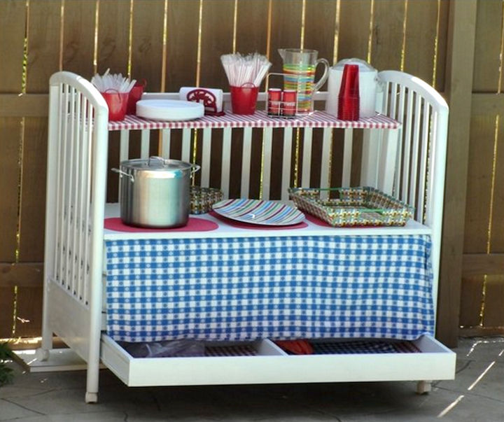 19 Ways to Repurpose Baby Cribs - Create an outdoor serving table on wheels.