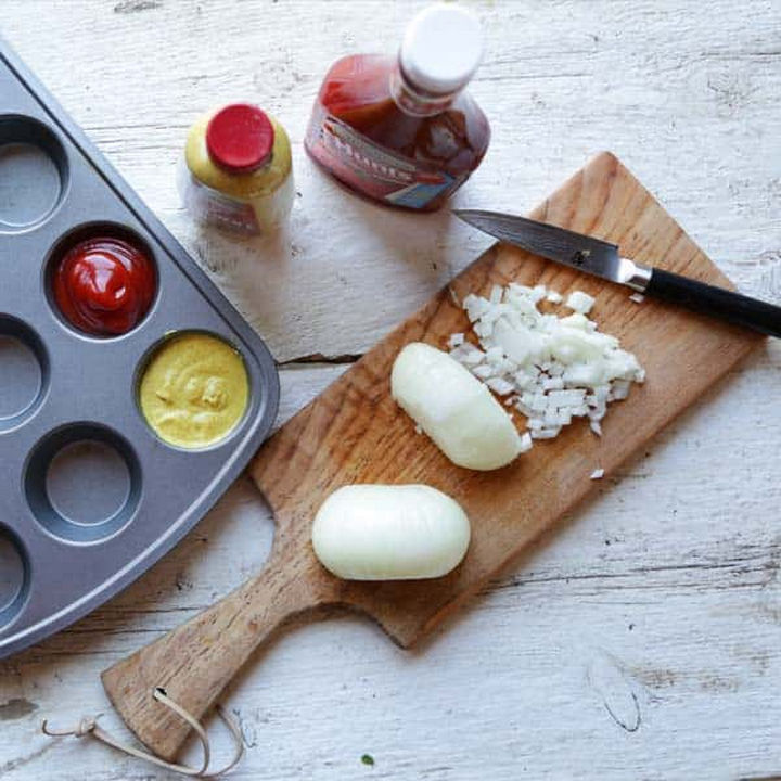 13+ Muffin Pan Hacks - Serve condiments in a muffin tray.
