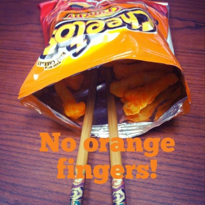 17 Life Hacks to Help Simplify Your Life - Prevent cheesy fingers by using chopsticks when eating cheese puffs.