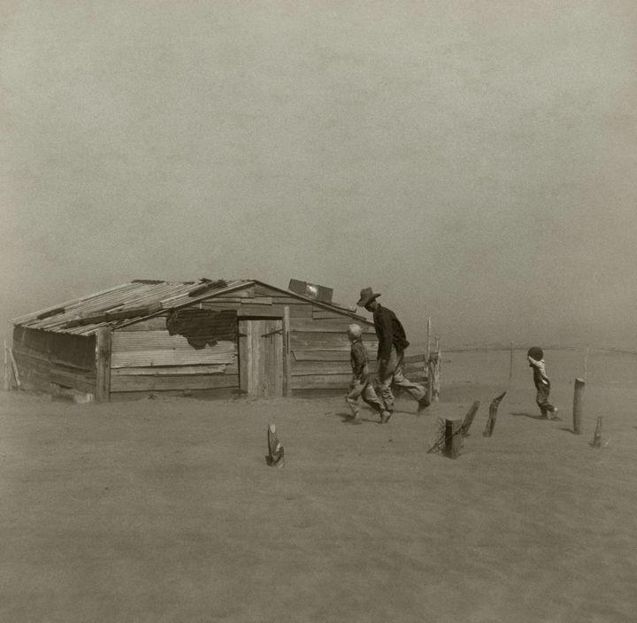 35 Rare Historical Photos - 1936: A farmer and his sons walking through a dust storm in Oklahoma.