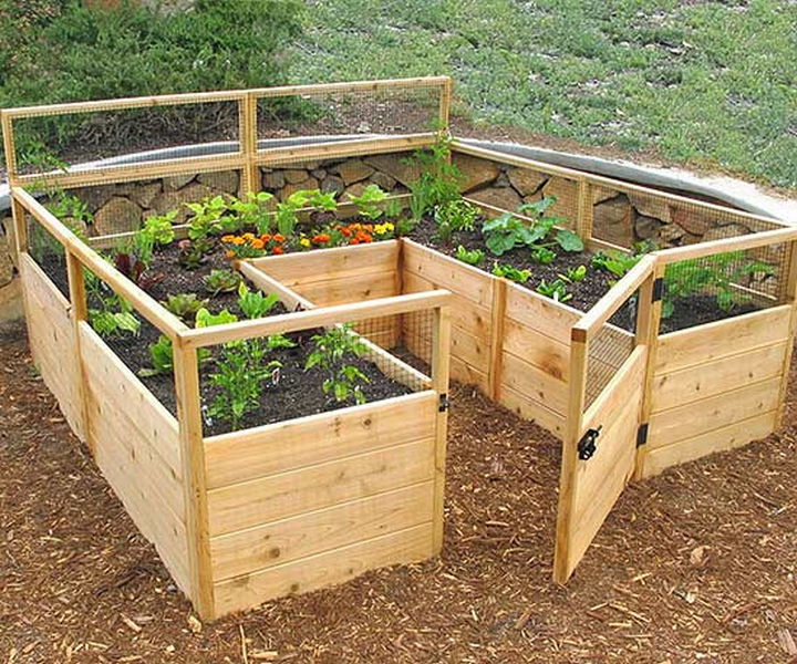 14 DIY Gardening Tips & Projects - Build a raised garden for low-maintenance gardening.