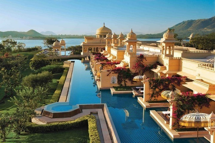 35 Epic Swimming Pools From Around the World - The Oberoi Udaivilas pool on the shore of Lake Pichola in Udaipur, India.