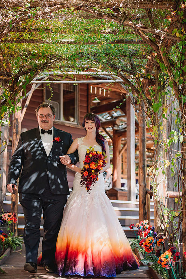 Her wedding dress seems to amplify all of the colors around her as she walks down the aisle.