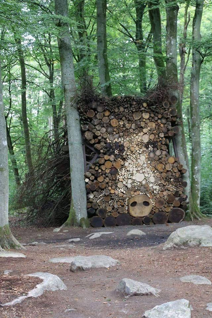 13 Displays of Stacked Wood Art - I wouldn't want to mess around with this giant wild boar.