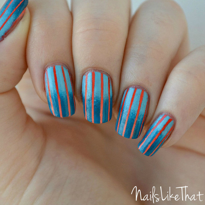 Orange and blue look great together with these reverse gradient nails.