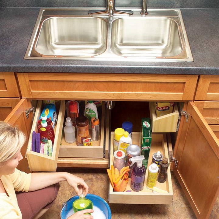 18 DIY Storage Ideas For Your Home - Organize the space under your kitchen sink with easy to reach trays.