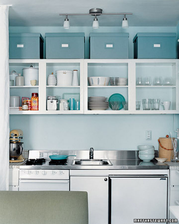 18 DIY Storage Ideas For Your Home - Make use of the area between the ceiling and your cupboard by organizing your kitchen with storage boxes.