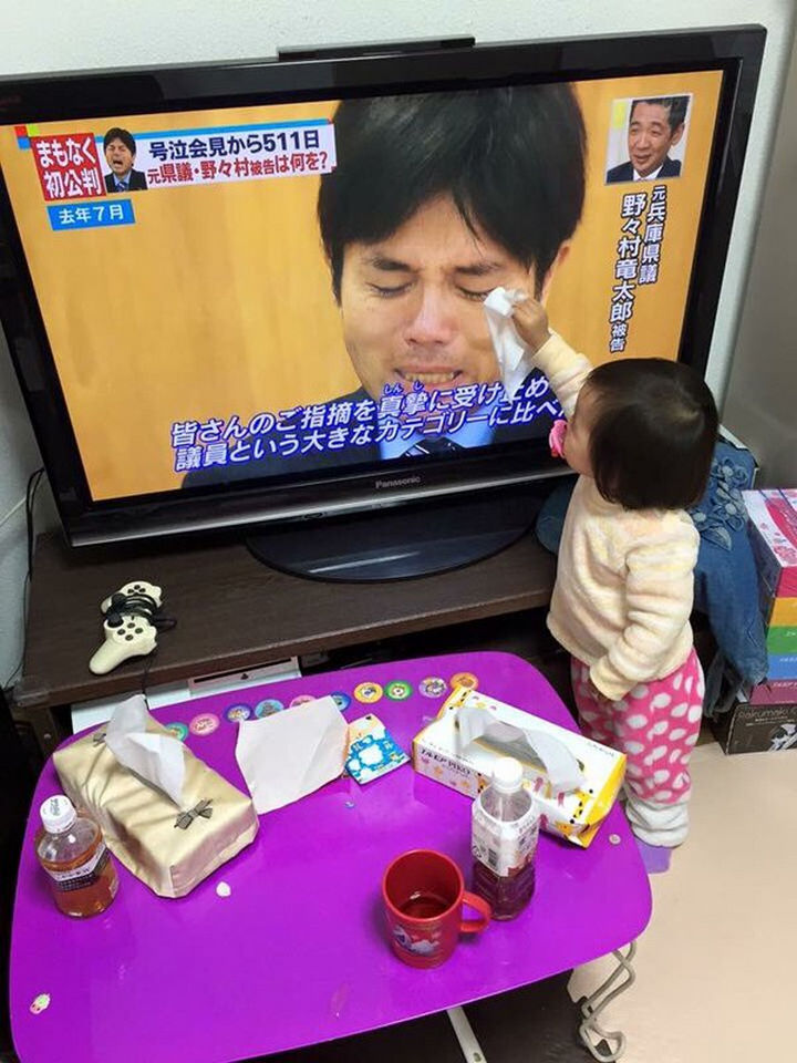 10 Random Acts of Kindness - A toddler wiping away tears from a man crying on television.