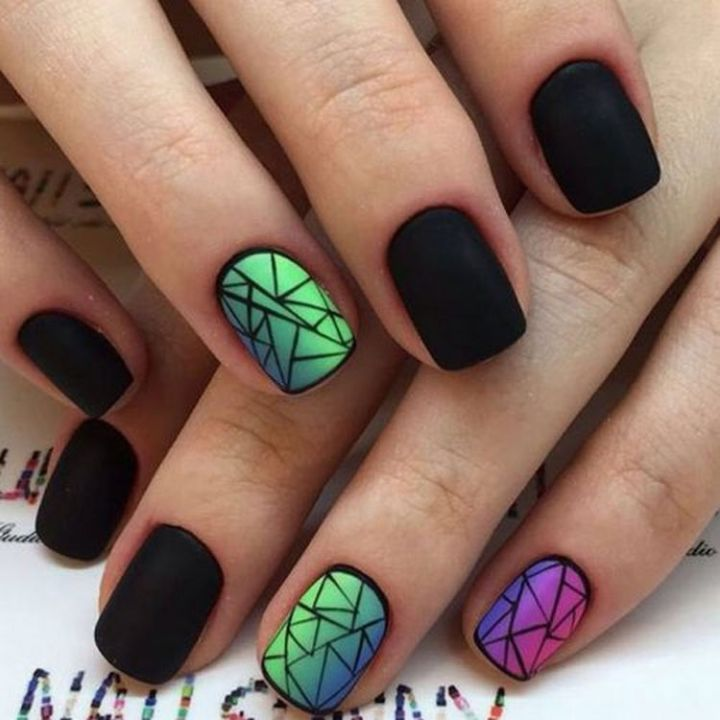 A winter mosaic of colors with a striking stained glass nail art design.