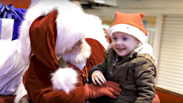 Mall Santa Signing with a Little Girl to Get Her Christmas Wish.