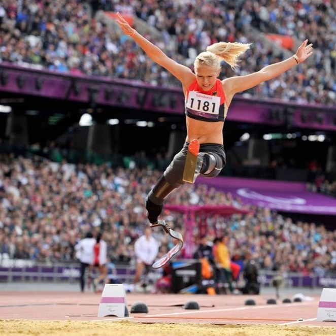 Vanessa Low, a2016 Paralympic champion performing aworld record-breaking 4.93-meter long jump.
