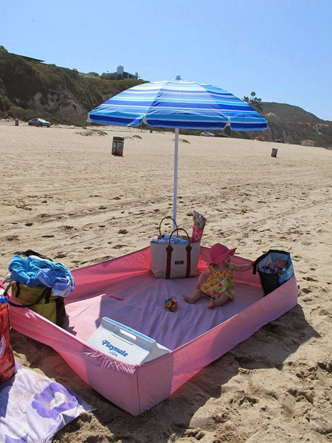 21 Best Mom Hacks - Place a fitted sheet with bags at each corner to keep the sand out at the beach.