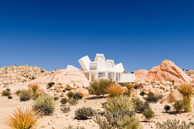 The design creates the illusion of a flower blooming in the middle of the desert.