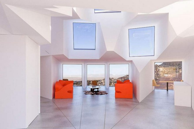 The living room features 3 southern-facing shipping containers to get a view of the desert.