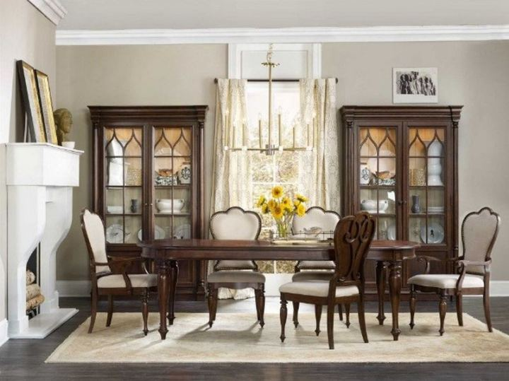 The gently rounded lines of this oval dining table promote better room flow and movement.