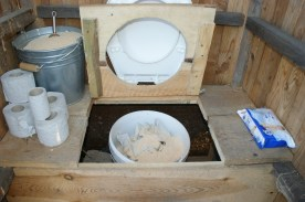 Open the hatch to remove the bucket