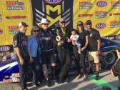 With team owner Ken Black and family