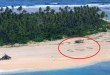 Photo of Three men who went missing for nearly 3 days are rescued from tiny Pacific island after writing giant SOS in sand (video)