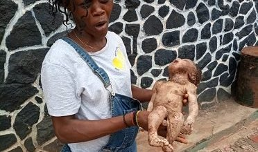 Photo of Wicked Woman dumps own baby inside pit toilet