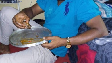 Photo of Nigerian doctor shares a photo of himself enjoying a pot of his faourite dog meat delicacy