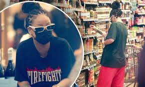 Photo of Rihanna Goes Grocery Shopping In Red Flare Pants & Vintage Tee: Pic