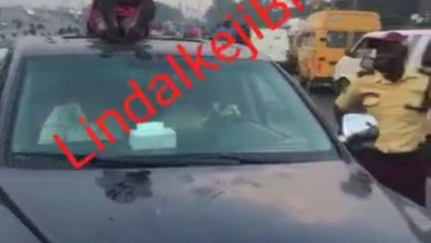 Woman creates a scene as she climbs on roof of car to prevent LASTMA officials from driving it off