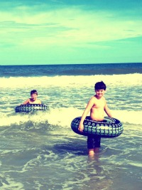 boys on tubes at Carolina Beach