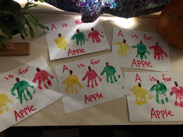 One of our favorite art activities! Apple handprints