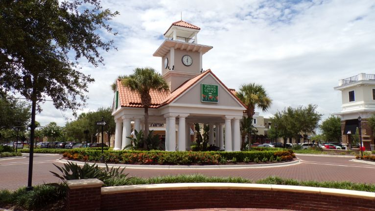 This is a central sitting area in Winter Garden Village shopping. The Village has 80 or so stores, restaurants and more. This clock tower is surrounded by Bonefish Grill, Aji Sushi and Teppan Japanese Restaurant