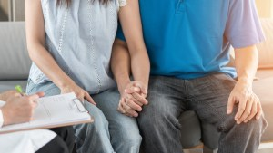 couple holding hands at preconception appointment