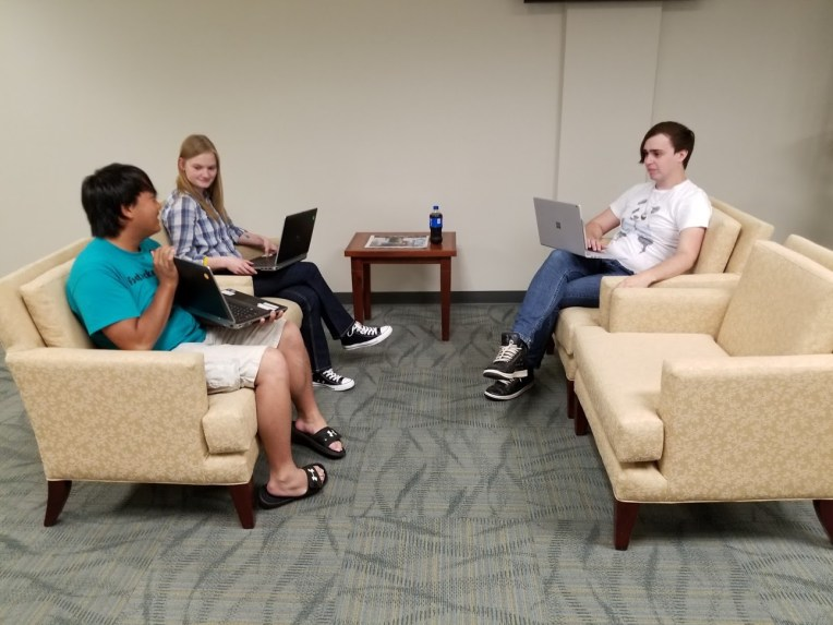 Image of three WIPPS interns at work on a project.