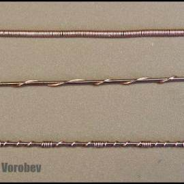 Wire wrapped jewelry. Basic weaves to use with one wire frames.