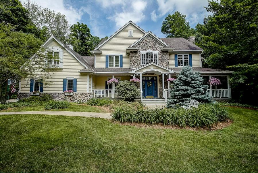 Waukesha WI Homes with In Law Suite For Sale     Realty Solutions Group The serenity of the North Woods meets the convenience of location with this  breathtaking craftsman nestled