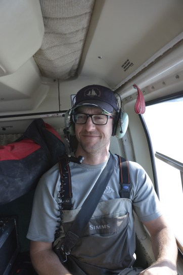 Andrew in the helicopter on the way to work in the field.