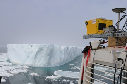 The laser scan equipment mounted and in use for surveying an ice island fragment. Photo credit: Gabriel Joyal