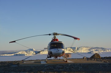 Helicopter resting for the 'night' with the Campbell Ice Tongue in the background (D.Mueller)