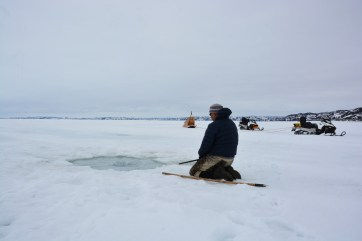 Our guide, Ted Irniq, patiently waiting for a group of seals to resurface while out on Frobisher Bay, NU. (A.Garbo)
