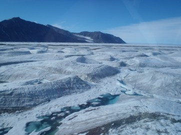 View of the Milne Ice Shelf as seen from the helicopter, while enroute to field site.