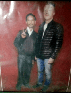 """One day we took a rickshaw which was driven by """"Supersamuel"""". He had Macklemore stickers on his auto and a picture of his father next to Macklemore behind his seat. """"Macklemore is my friend"""", is what he said. And actually, I think this picture is real."""