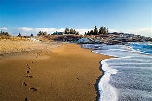 Photo from DownEast Magazine. Beach and rocky headland at Reid State Park, Maine. 20 miles from Wiscasset Woods Lodge