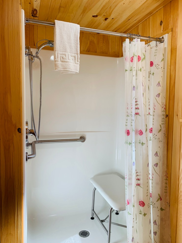 The roll-in shower in our handicap accessible room at Wiscasset Woods Lodge in Midcoast Maine.