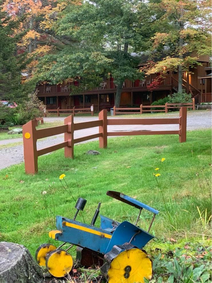 Toy tractor in front of Wiscasset Woods Lodge