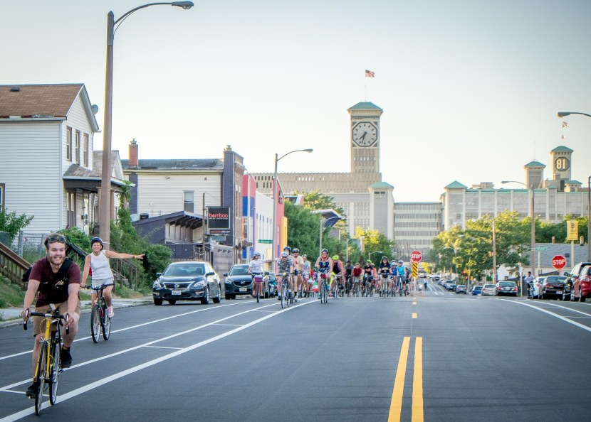 People ride past the Polish Moon clock tower