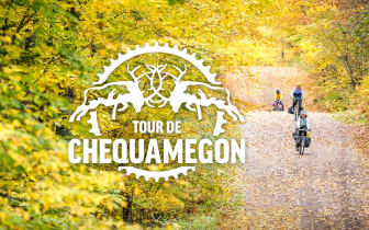 Tour de Chequamegon logo over photo of people riding on gravel road in fall colors