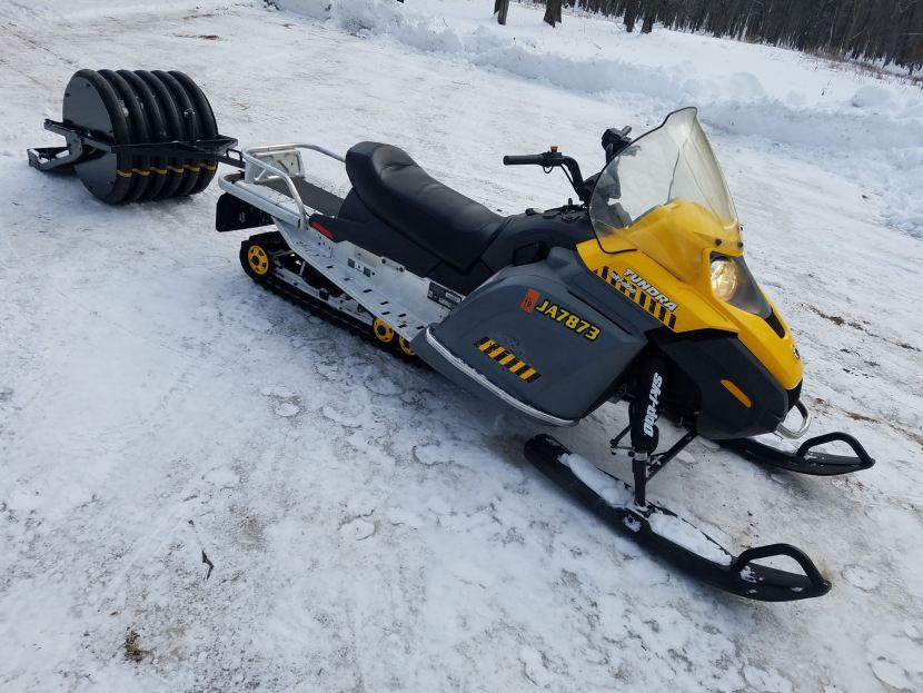 snowmobile with a groomer attached