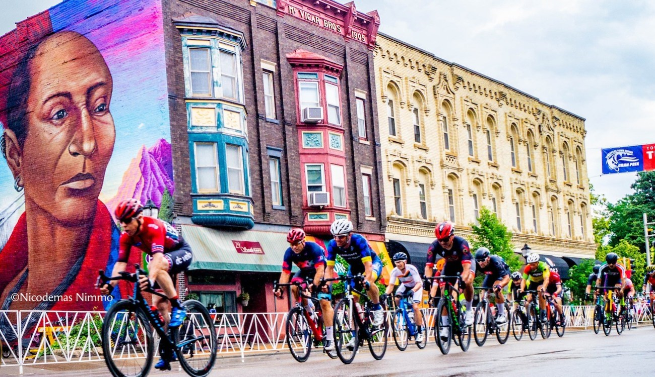 bike racers ride in downtown janesville, wi