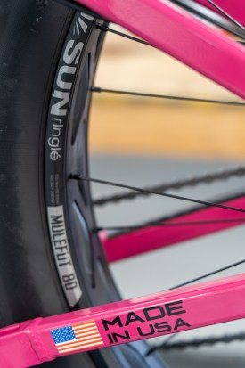 fat bike tire and tube next to pink made in USA stays