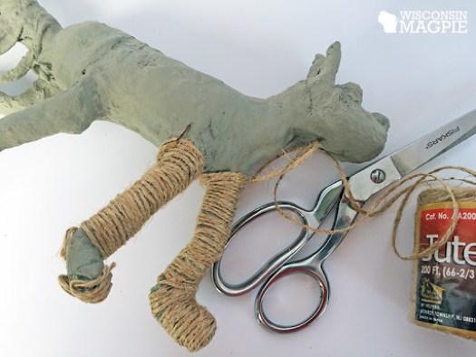 covering a paper mache dog in jute twine