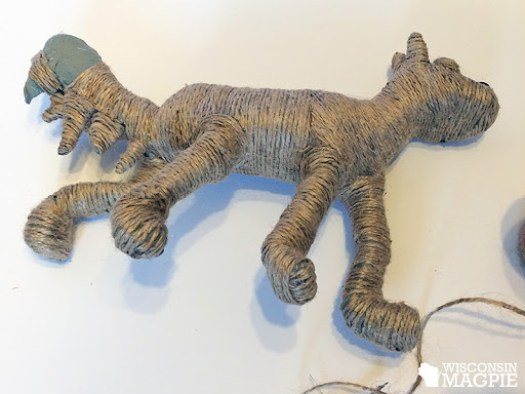 covering a paper mache dog in jute twine